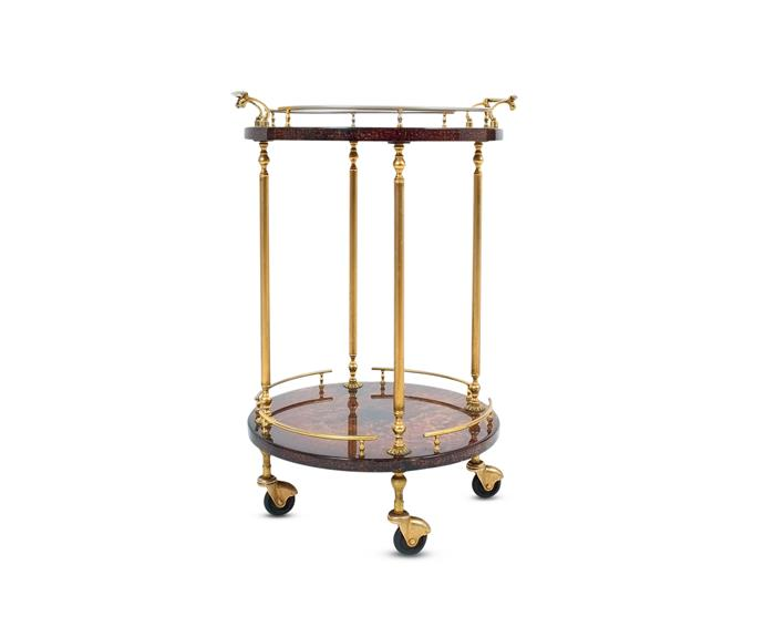 "Italian craftsman Aldo Tura's 'Petite' bar cart, POA, with bronze detailing, makes a statement while also functioning well in small spaces. [1st Dibs](https://www.1stdibs.com/|target=""_blank"")."