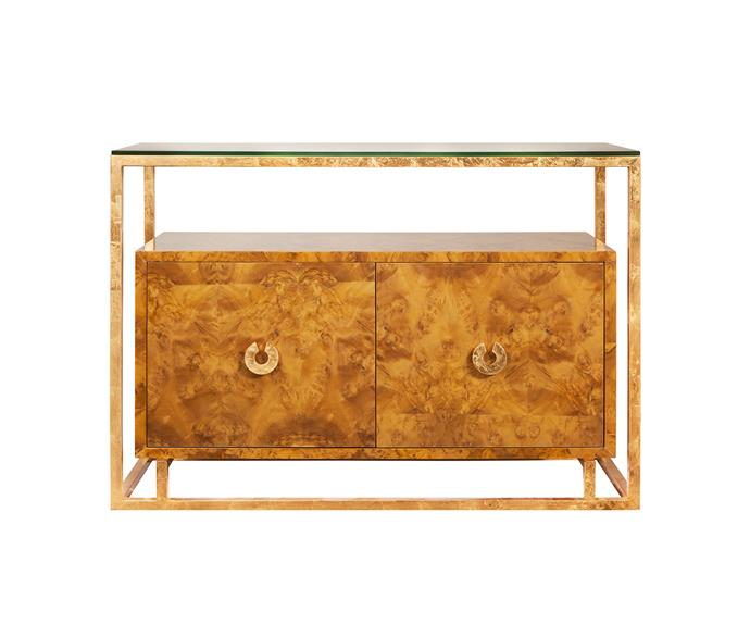 The natural beauty of burlwood is enhanced by a gold leaf frame and hardware to give the 'Juno' console, designed by Worlds Away, a luxurious touch, Regency Distribution.
