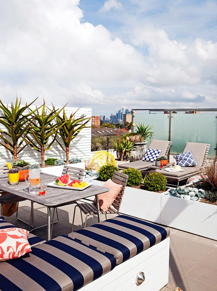 "This rooftop garden has been decked out with furniture for entertaining and relaxing, colourful [outdoor decor](https://www.homestolove.com.au/outdoor-decor-australia-20799|target=""_blank"") and hardy plants. With views of the Sydney city skyline, this rooftop terrace would be the perfect place for summer soirees!"