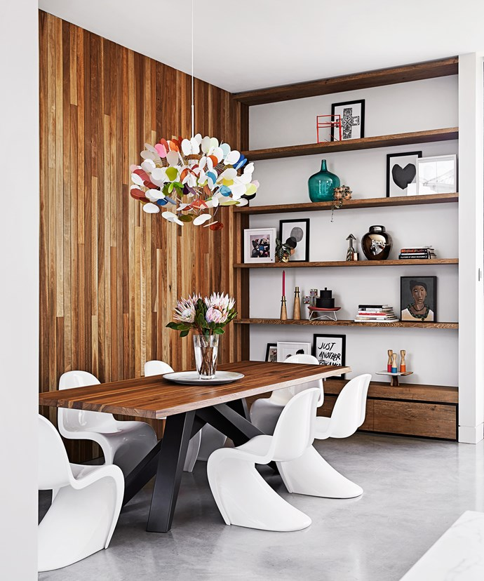 The colour palette for the house is white, black and grey, with elements of timber – such as spotted gum wall panelling in the dining room – to help soften the look.
