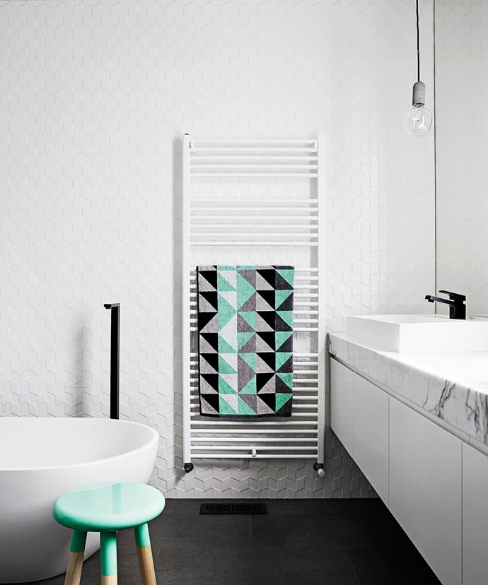 "Minty fresh Italian ceramic wall tiles and a double vanity with calacatta marble benchtop scream elegance in the bathroom, while black tapware from [Reece](http://www.reece.com.au/?utm_campaign=supplier/|target=""_blank"") and a concrete [NUD](http://nudcollection.com/?utm_campaign=supplier/