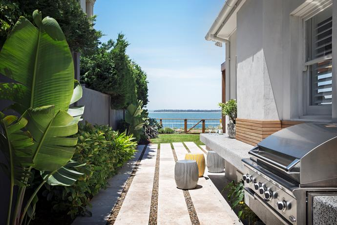 "The lines of travertine paving at the side of the house have a strong visual and gravitational effect, directing guests. ""They lead guests down the side of the house to the rear of the property,"" says Matt. ""They connect all the areas."""