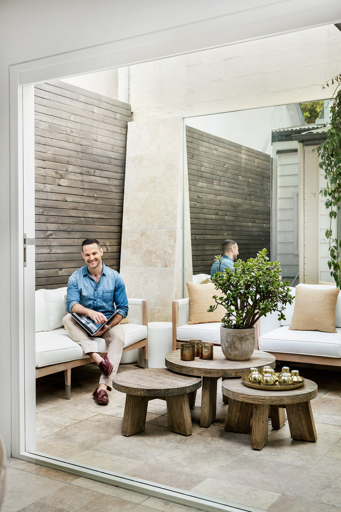 "Interior designer Darren Palmer added an internal courtyard to his [inner-city home](https://www.homestolove.com.au/darren-palmers-contemporary-classic-family-home-2993|target=""_blank"") to create a light and airy sanctuary that connects to the outdoors. The courtyard is now a place that Darren finds himself drawn to. ""It was a no-go zone before, but now it begs you to lie on the sofa and relax,"" he says."