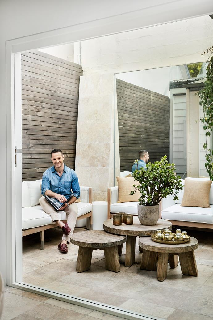 "The courtyard is now a place that Darren finds himself drawn to. ""It was a no-go zone before, but now it begs you to lie on the sofa and relax,"" he says. Reef 3-seater sofa and Granada grey nesting tables, [Globe West](http://www.globewest.com.au/?utm_campaign=supplier/