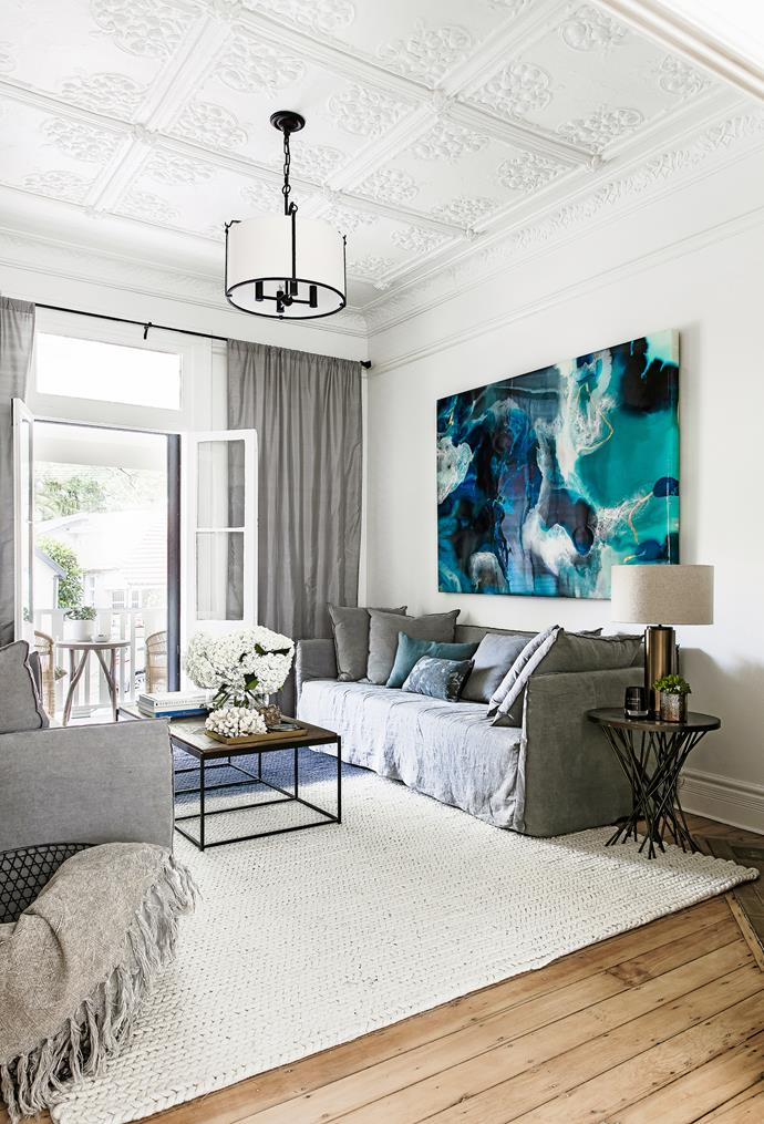 "The third bedroom is currently set up as another retreat space, anchored by a Hyam rug that is part of Darren's range for [Carpet Court](https://www.carpetcourt.com.au/?utm_campaign=supplier/|target=""_blank""). Plush linen sofas, [Urban Couture]((https://www.urbancouture.com.au/?utm_campaign=supplier/