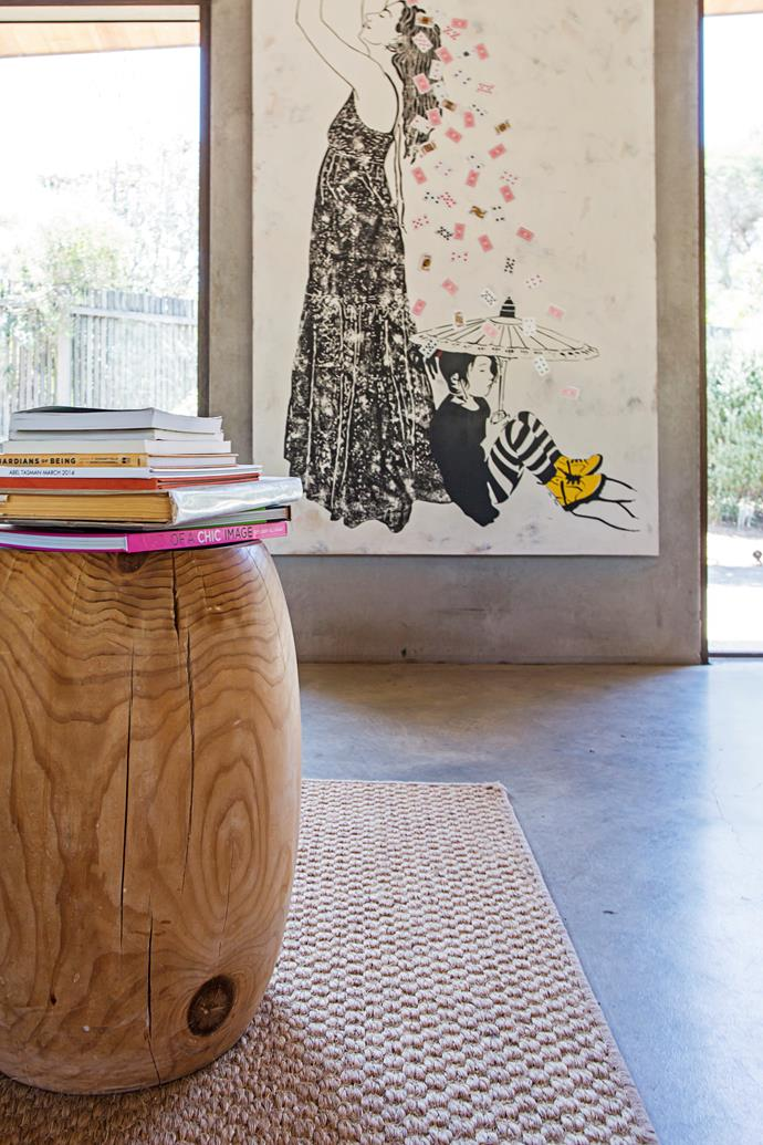 Large artworks look great on the concrete walls of the living room.