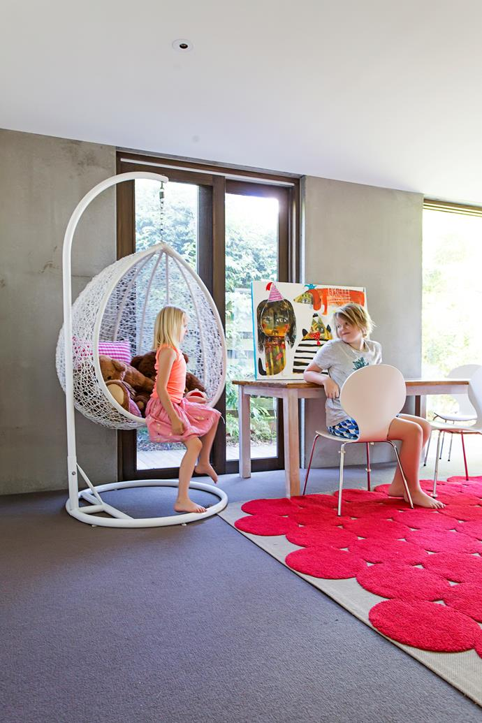 "Having a good-sized playroom for the kids was a great idea. ""It's both easily hidden and yet it's at the centre of the house,"" she expalins. The room features a swinging chair from [Milan Direct](http://www.milandirect.com.au/
