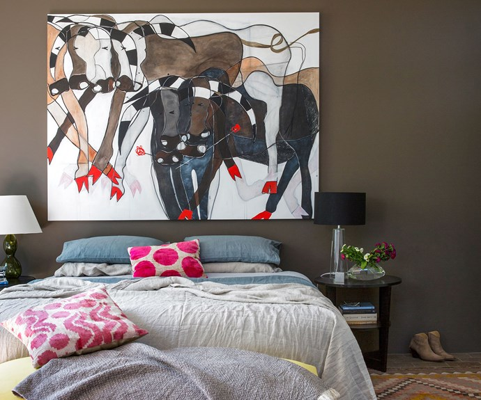 Bedroom with large artwork above bed