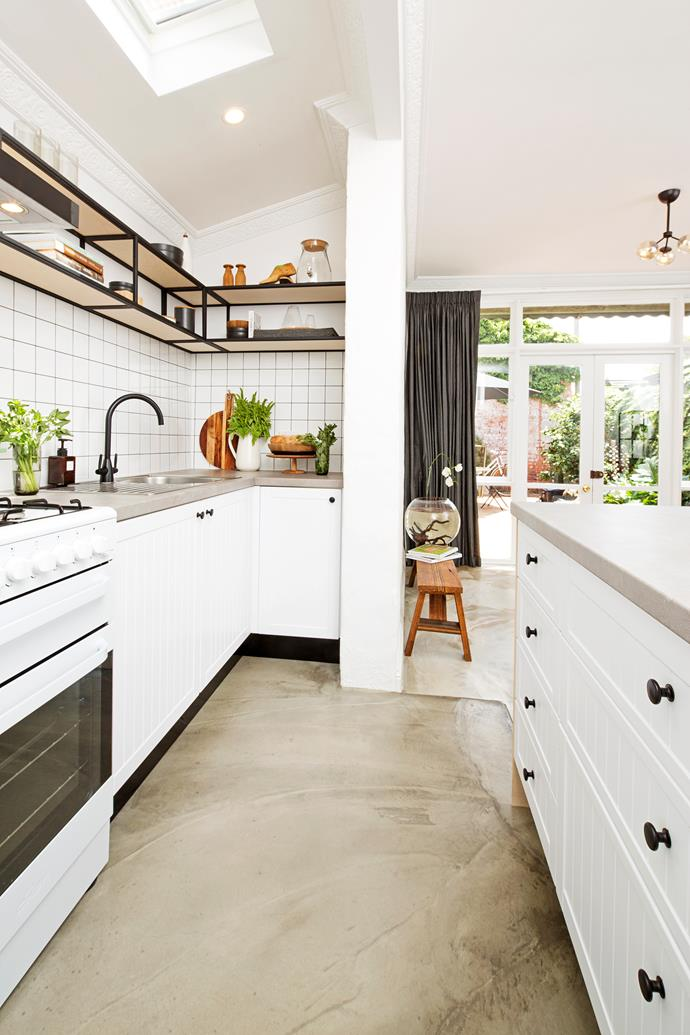 Traditional cabinet doors are jazzed up with industrial-style details such as polished concrete flooring and steel-frame shelving.
