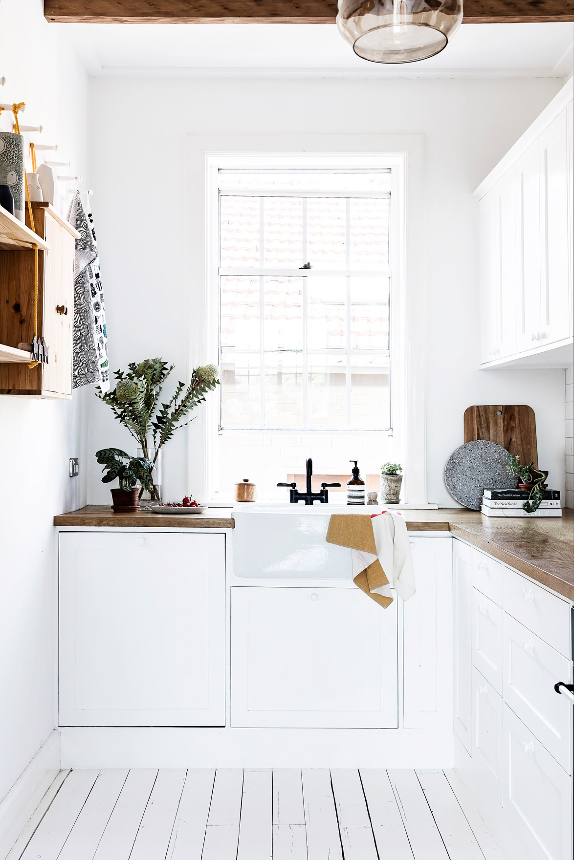 "[Painting the floorboards](https://www.homestolove.com.au/how-to-paint-a-floor-10126|target=""_blank"") white has helped to create a relaxed coastal feel in this [Sydney apartment](https://www.homestolove.com.au/sydney-apartment-gets-swedish-summer-house-makeover-3050