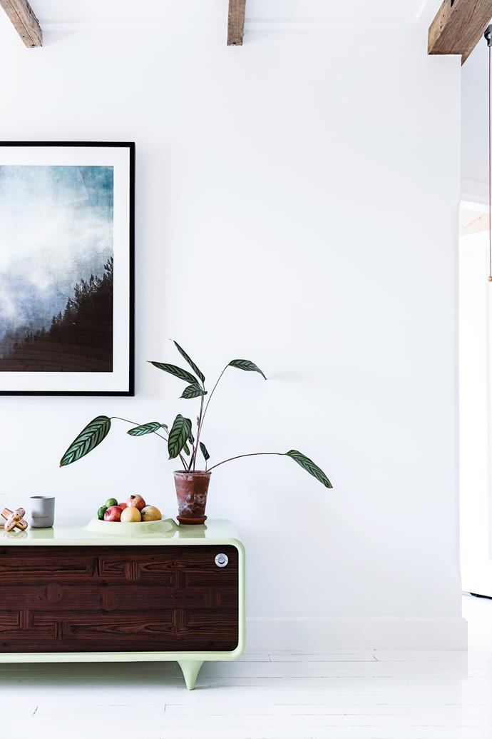 "A photographic artwork by Sophia Szilagyi, from [Otomys](http://otomys.com/|target=""_blank""), sits above a credenza that was one of Fräg's designs for [Woodmark Australia](http://www.woodmark.com.au/