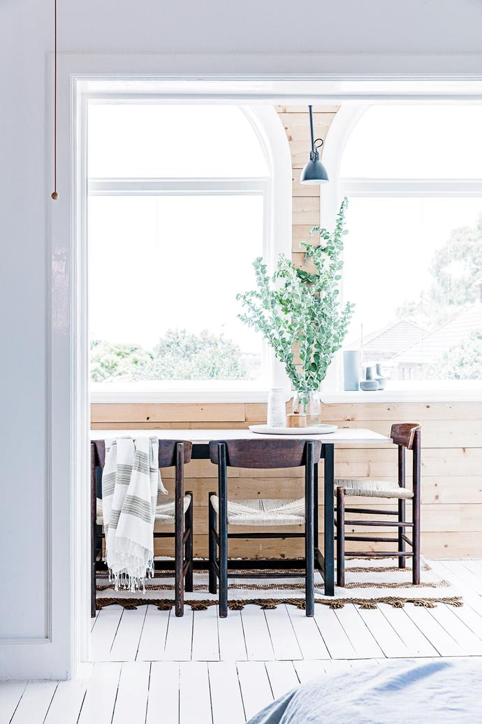"Fräg utilised his craft skills to add architraves and windowsills to the sunroom, used as a dining space. He also made the dining table for the room. The chairs are Borg Mogensen ""J39"" dining chairs."