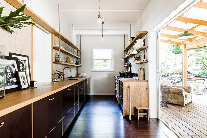 """The clever design of this kitchen allows it to open up to the garden for easy outdoor entertaining. Appliances are tucked neatly under the bench for a sleek look. Take a tour of [this contemporary beach shack](http://www.homestolove.com.au/pittwater-beach-shack-gets-a-heartfelt-renovation-3064