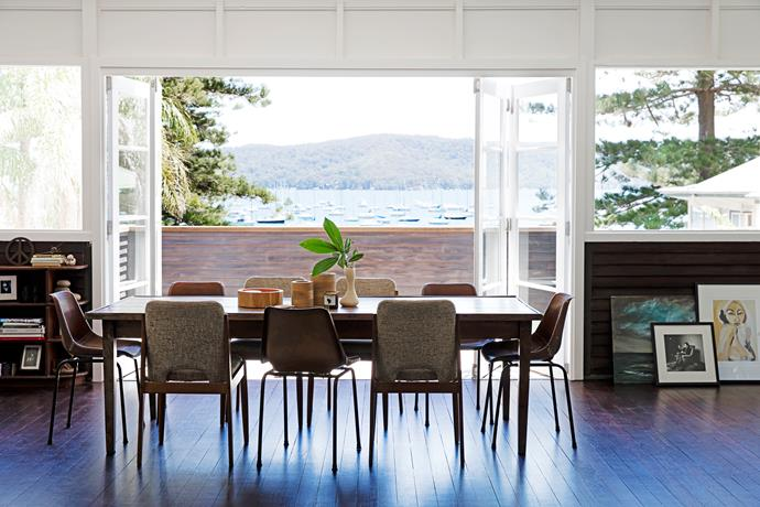 I love how the doors in the dining area frame the views over Pittwater. I've had this dining table for over 20 years and the fabric chairs were found on the side of the road (honestly!). We suspect they're by Australian designer Fler. The ocean painting was another roadside find; next to it is a print by Mia Oatley and a photographic print of John Hurd by John Stoddart.