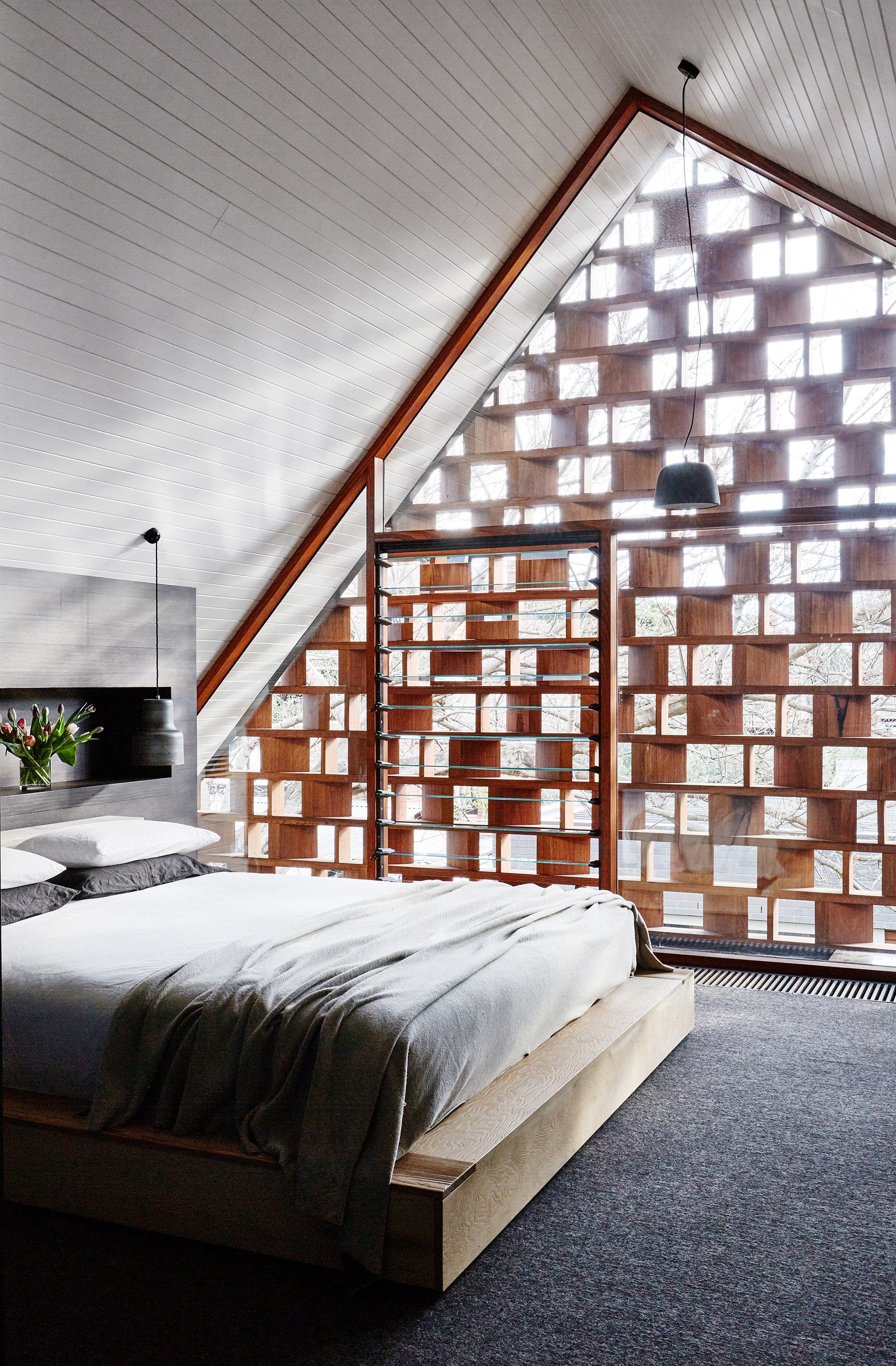 A custom timber screen was designed to provide this master bedroom with privacy, but has also become one of the most distinctive features of this [renovated Californian bungalow in Melbourne](http://www.homestolove.com.au/architects-serve-up-cafe-aesthetic-for-suburban-home-3089). Photo: Sean Fennessy / *Belle*