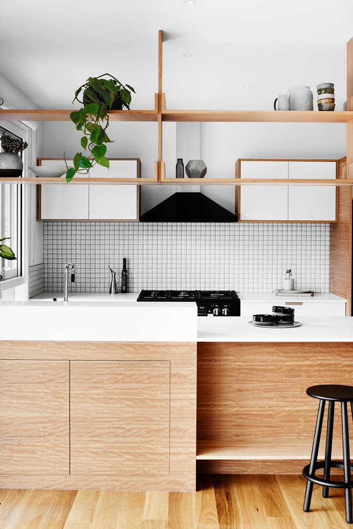 A raised block conceals the busiest work area of the kitchen and hides any potential mess. At the front, two 1200x300mm cupboards house the couple's wine collection.