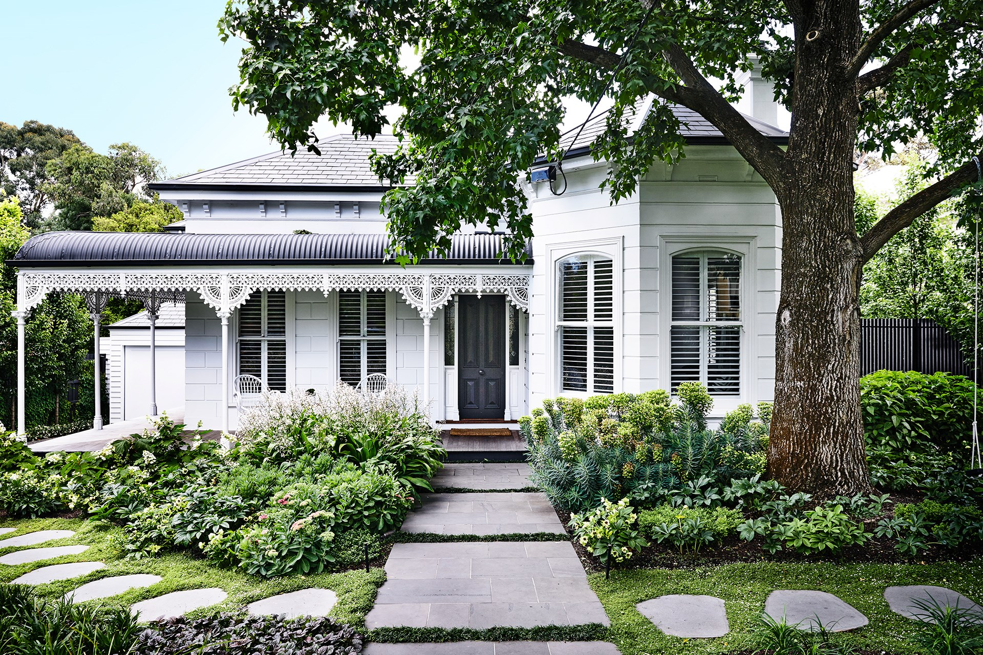 """This garden is so abundant and established it looks as though it's been the life-long companion to the Victorian-era weatherboard home it surrounds. In fact, it's a recent development, [installed in tandem with the home's renovation two years ago](http://www.homestolove.com.au/a-garden-of-contrasts-that-works-harmoniously-3105