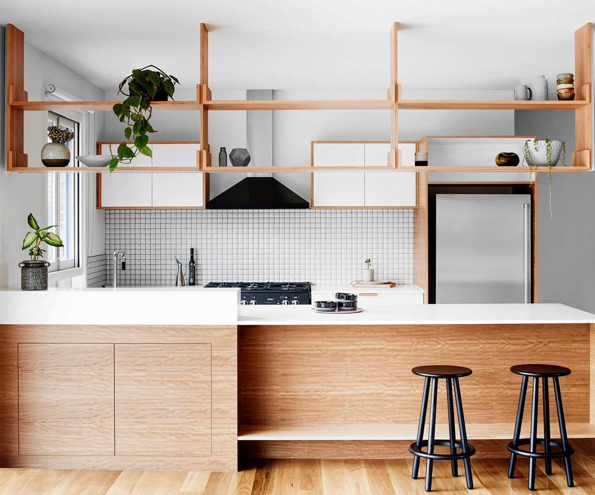 "Inspired by 1970s-style joinery, the suspended blackbutt shelving in the kitchen of [this Melbourne home](http://www.homestolove.com.au/open-plan-retro-inspired-kitchen-reno-3103|target=""_blank"") acts as a visual divide between the kitchen and living area, and as a display surface for plants and objects. Photo: Tom Blachford / *Australian House & Garden*."