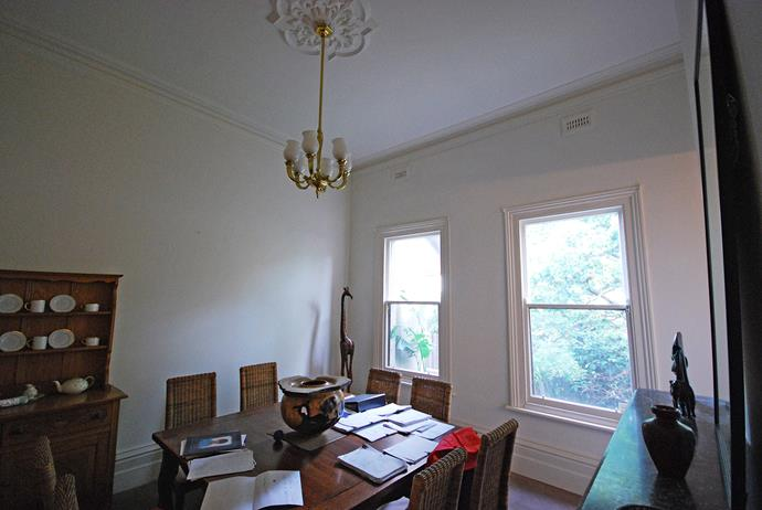 **BEFORE:** The original dining room was converted into a home office that retains the beautiful Victorian features of this heritage property.