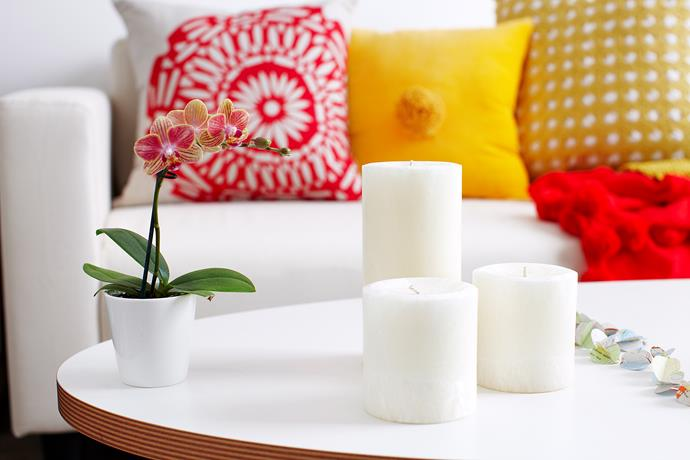 Create the perfect ambiance in your home by bunching your candles together. Will Horner / *bauersyndication.com.au*