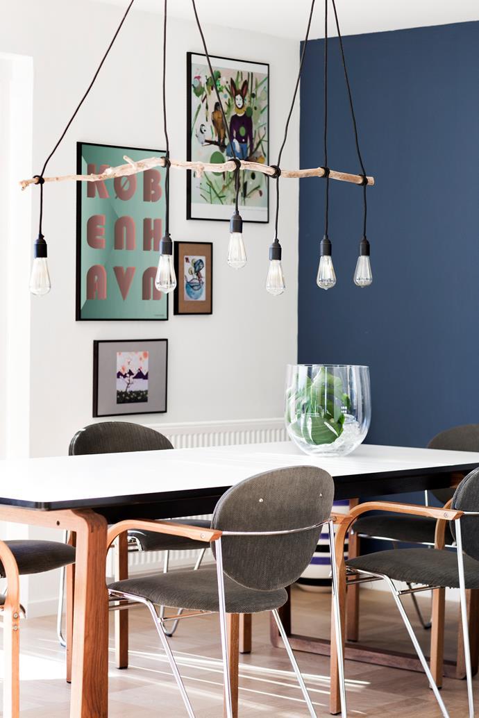 "Lucci Karbon Pilot **globes** from [Beacon Lighting](http://www.beaconlighting.com.au/?utm_campaign=supplier/|target=""_blank""), [Bolia](https://www.bolia.com/en/?utm_campaign=supplier/|target=""_blank"") **dining table**, second-hand Labofa chairs. Artworks by (clockwise from top left) Vissevasse, Kathrine Ærteberg, Iris Serrano and Mette Helena Rasmussen."