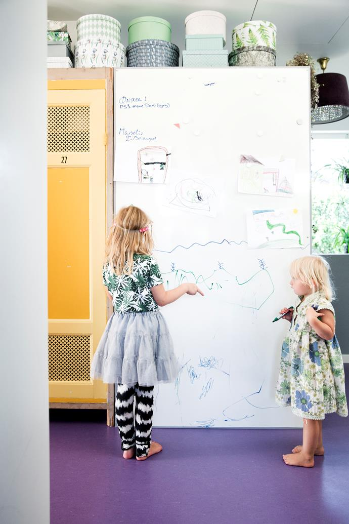 A whiteboard keeps the girls entertained for hours.