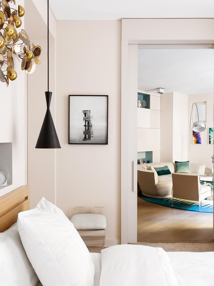 'Beat' pendant light by Tom Dixon in bedroom. Artwork by Noémie Goudal.