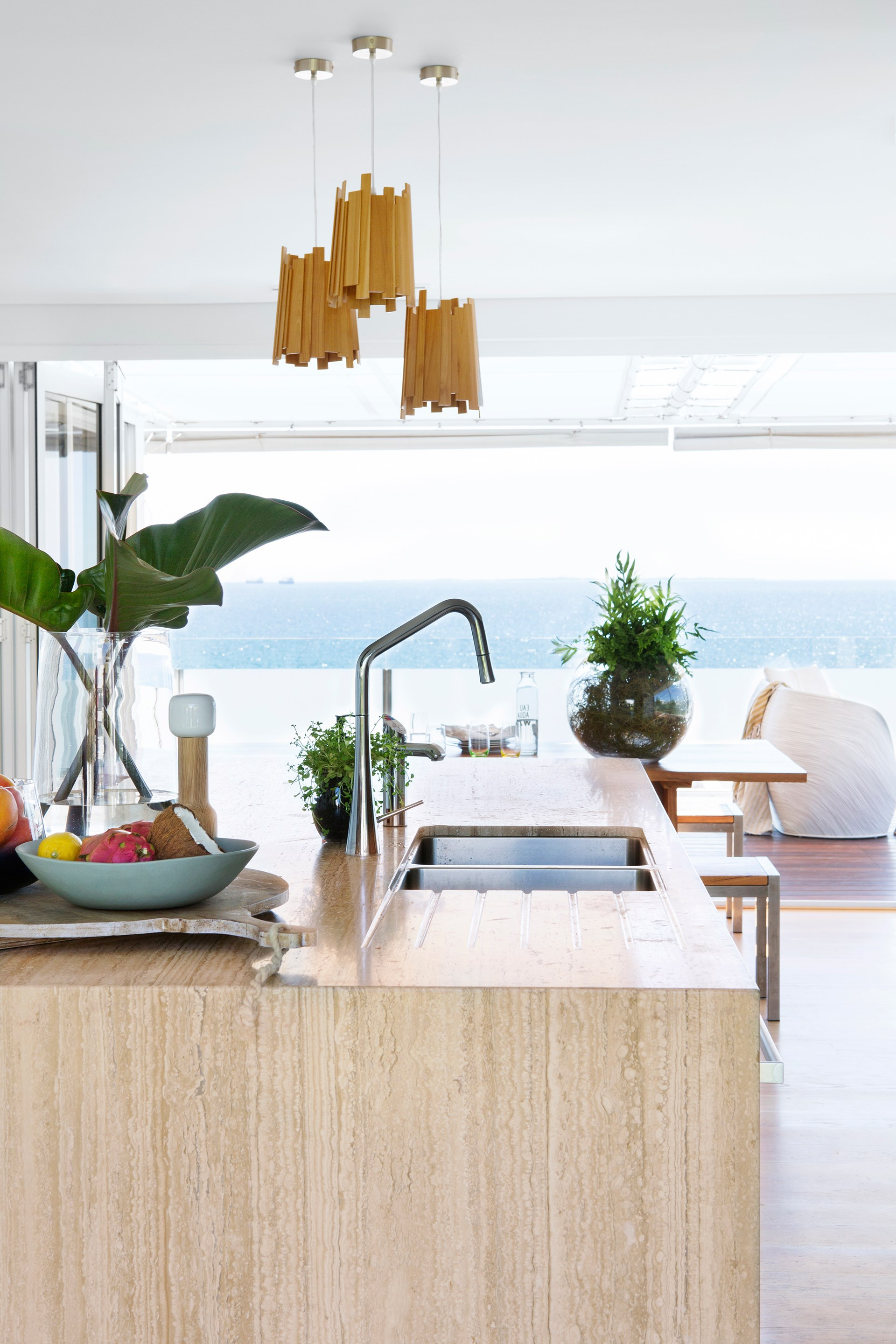 Reconfigured to take advantage of the jaw-dropping ocean views this [Perth beach house](http://www.homestolove.com.au/1990s-beach-house-revamp-3307) enjoys, the kitchen is now a stunning sandy-coloured jewel. *Photo: Angelita Bonetti*