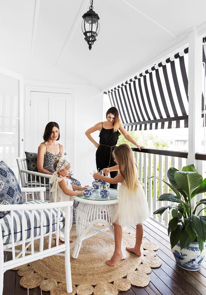 """Claudine's mother, Junette (seated) has a workroom just off the verandah where she enjoys sewing clothes for Evie and Georgia. Awning, [Kresta](https://www.kresta.com.au/