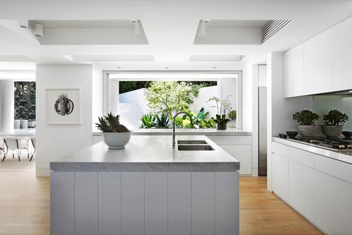 """Honed Carrara marble benchtops from [SNB Stone](http://www.snb-stone.com/ target=""""_blank"""") in the kitchen. Perrin & Rowe tap from [The English Tapware Company](http://www.englishtapware.com.au/ target=""""_blank""""). Pineapple on Hermès artwork by CJ Hendry."""