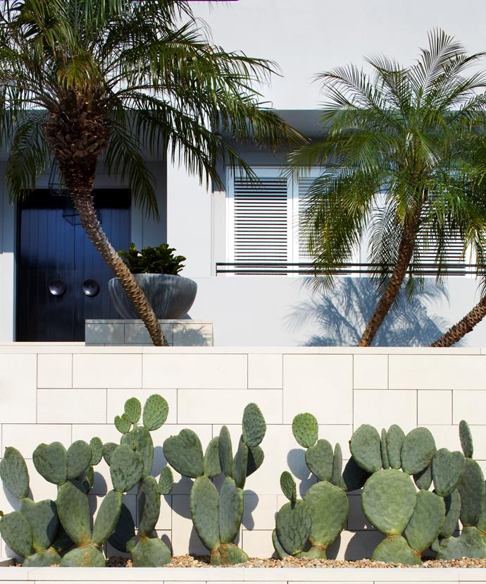 The exterior of the house is painted in cool grey and accented with shutters.