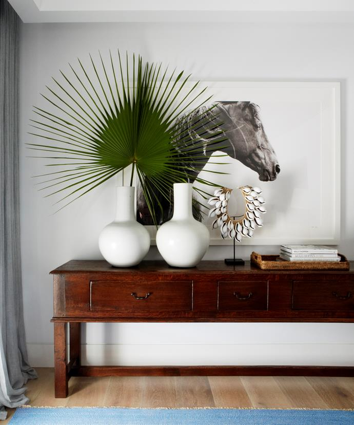 Custom-made credenza in the den. Black Beauty photo by Nick Leary from Wild Brumbies.