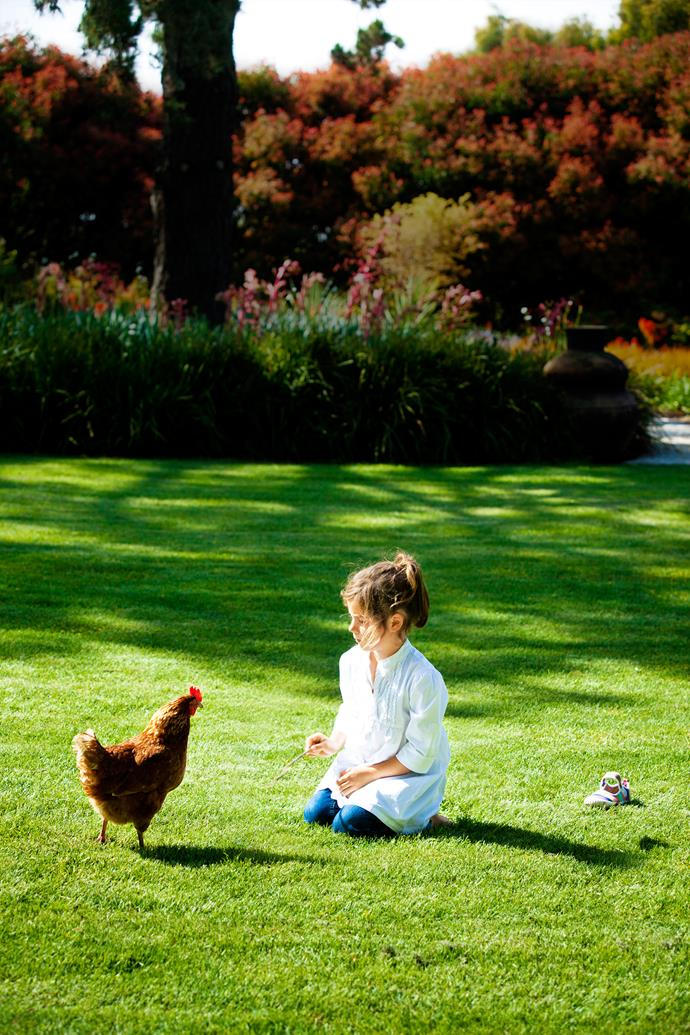 """Zara with feathered friend. """"A country garden just has to have chooks,"""" says Sophie. """"The kids love taking kitchen scraps to them and collecting the eggs."""""""