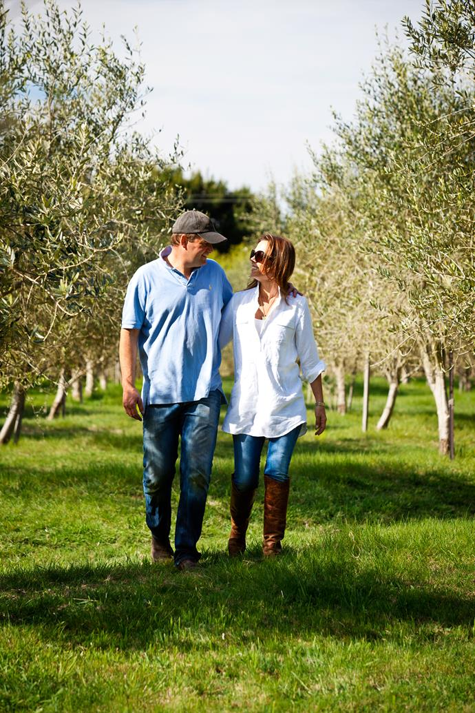 Tom and Sophie stroll through a grove of 370 olive trees. Their oil is marketed under the Highfields label.