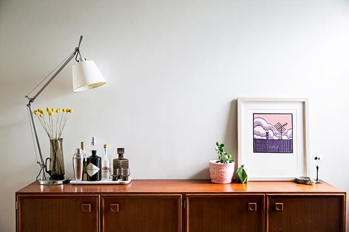 """The """"Rooftops"""" lino print is by Mahani. Sideboard from eBay."""