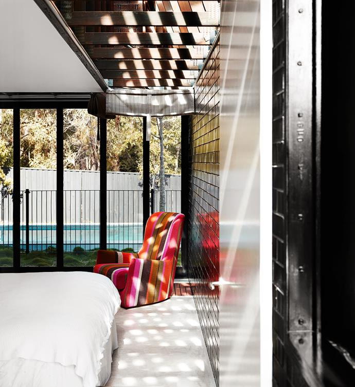 A comfortable armchair covered in Missoni fabric was used for breastfeeding – and sleeping – when Lisa's daughters were babies. The master bedroom overlooks the pool, which is at the back of the house.