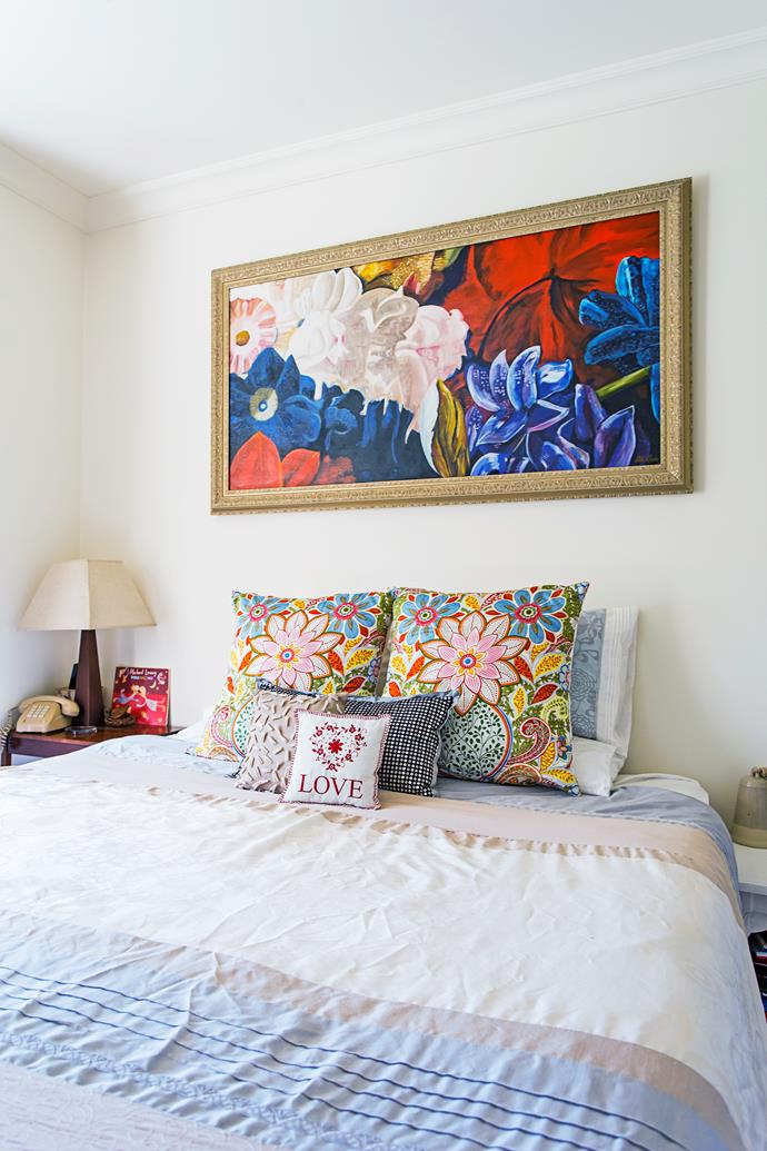 An oil painting by Damon's mother hangs in the master bedroom.