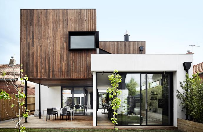 "American burnt ash cladding softens the contemporary design of this Melbourne home. ""It wraps around the house to form ceilings in the deck area, kitchen and entry, tying the spaces together,"" says homeowner Kate Lawlor."