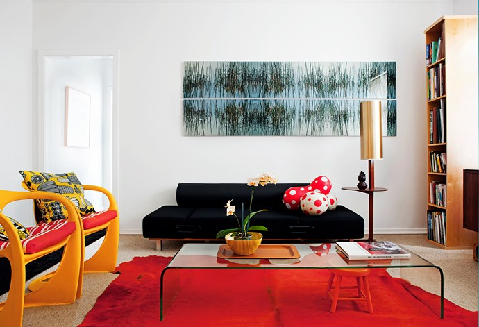 """Murray bought the dyed cowhide rug in the living room from Spence & Lyda. """"I love the intensity of the colour."""" The retro side table with standard lamp was a find from a friend, and Murray added the gold lampshade."""