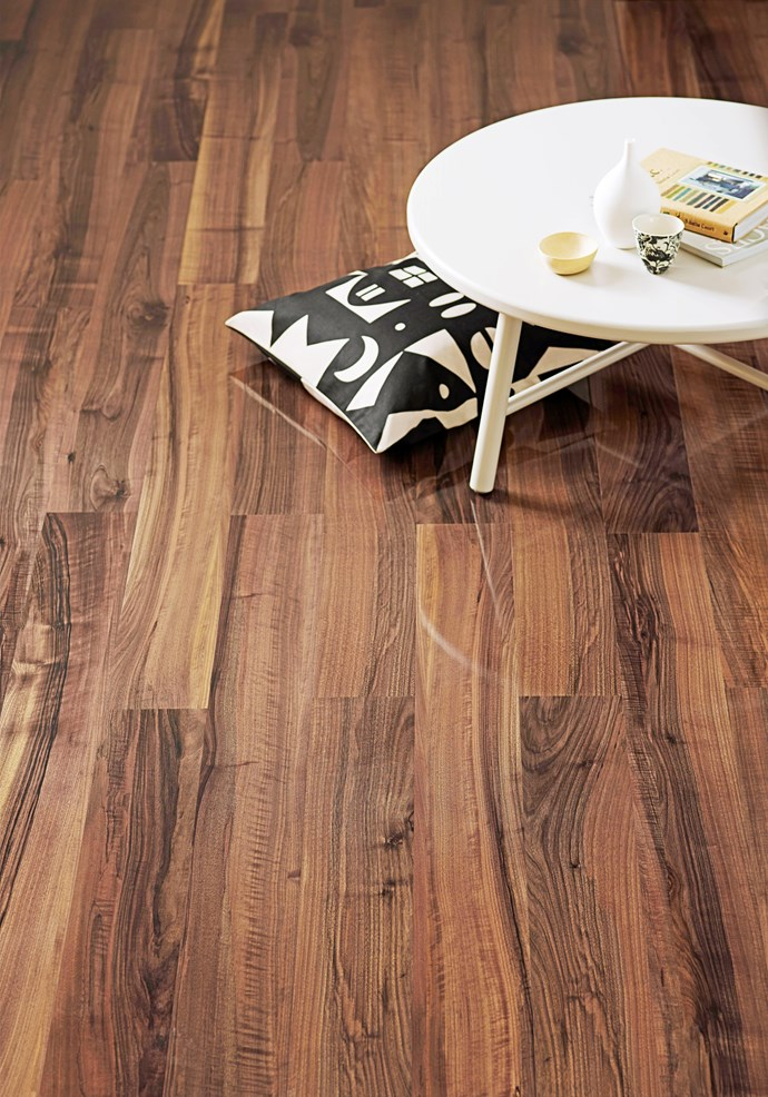Laminate flooring in Queensland Walnut Supergloss, from $41.25 a square metre, from Formica Flooring.