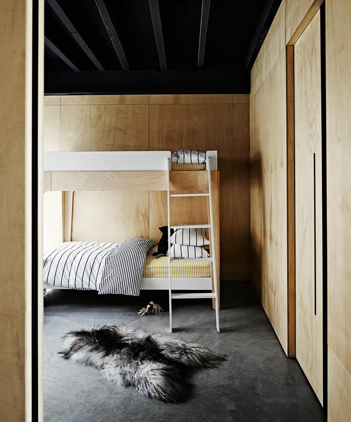 Heated polished concrete floors and an Icelandic sheepskin from Black Sheep (White Light) make for a supercosy bedroom for son Wolfe. The room opens onto a cycad garden; the species originating from the Jurassic period. Bedlinen is from Unison.