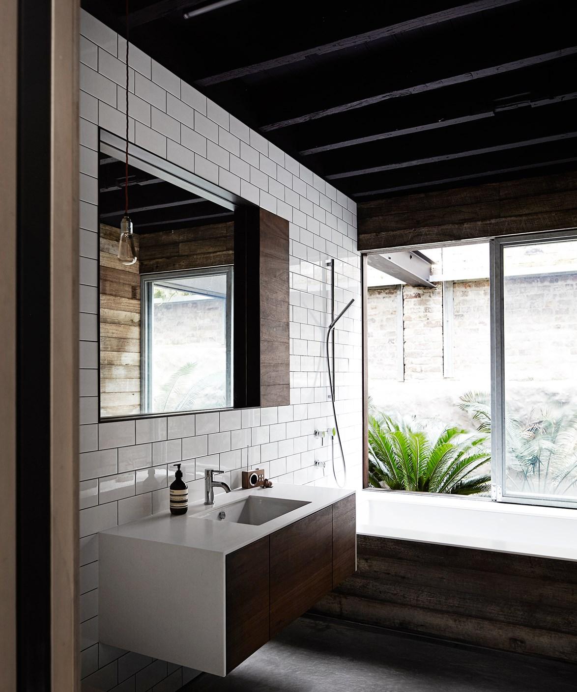 "[Comedian Merrick Watt's bathroom](https://www.homestolove.com.au/inside-comedian-merrick-watts-happy-home-3465 target=""_blank"") is no laughing matter with it's sleek, mid-century vibe. Photo: Sharyn Cairns / *real living*"