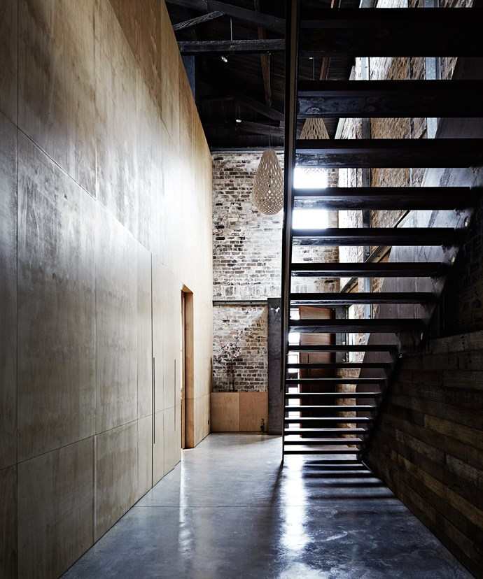 """""""There are no plaster or gyprock walls in the house,"""" Georgie says. """"Instead, plywood is used to ground the space. Merrick grew up in a mud-brick house, so natural elements were imperative for him."""""""