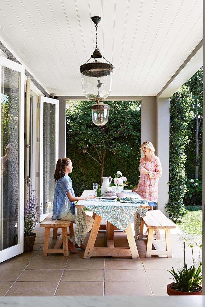 Olivia (left) and Melinda on the new covered verandah, which sees plenty of use year-round.