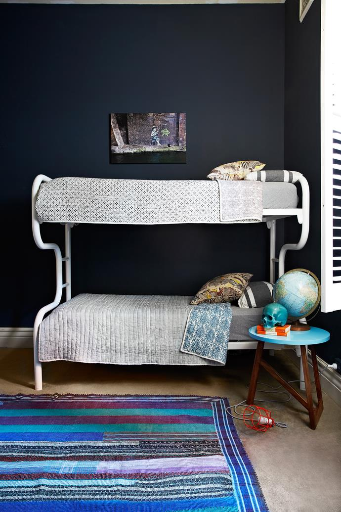 The navy wall colour, Porter's Paints Polo, creates a dramatic background for colourful accessories.