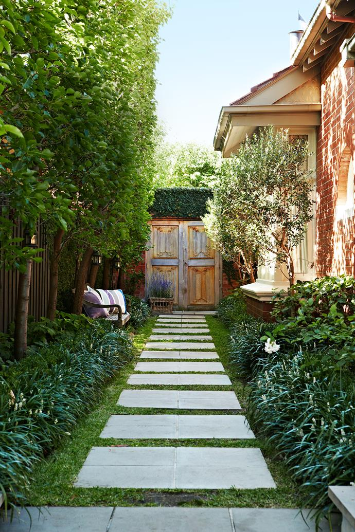 "Melinda and Simon landscaped the garden themselves. The teak doors were picked up in Java while on a furniture-buying trip. ""We knew they would make a fabulous feature in our garden,"" says Melinda. ""It was well worth the effort to get them here."""