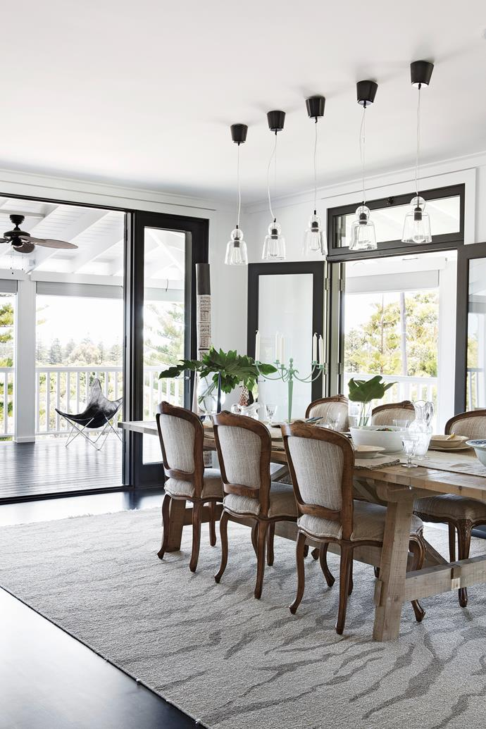 """This space sets up a dynamic design tension between traditional upholstered chairs and contemporary furnishings. Table and ceramic tableware, [Blu Peter](http://www.blupeter.com.au/?utm_campaign=supplier/ target=""""_blank""""). Candelabra, [Empire Highgate](http://www.worldofempire.com/?utm_campaign=supplier/ target=""""_blank""""). Rug, [Jenny Jones Rugs](http://www.jennyjonesrugs.com/?utm_campaign=supplier/ target=""""_blank"""")."""