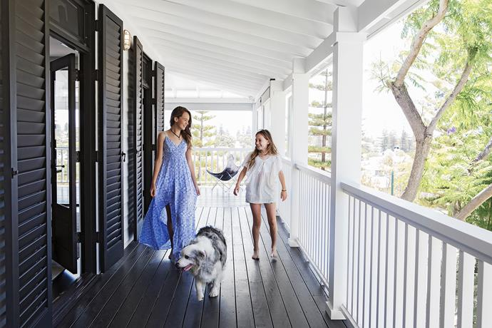 """Princess Indigo joins sisters Eloise and Lexie on the deep and shady verandah. Butterfly chair, [Blu Peter](http://www.blupeter.com.au/?utm_campaign=supplier/ target=""""_blank""""). The jarrah decking timber has been treated with a [Sikkens](http://tenaru.com.au/?utm_campaign=supplier/ target=""""_blank"""") finish in Ebony."""