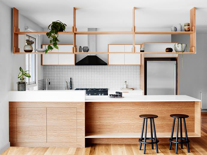 "The suspended blackbutt shelving in this [kitchen renovation](http://www.homestolove.com.au/open-plan-retro-inspired-kitchen-reno-3103|target=""_blank"") was inspired by 1970s-style joinery. Photo: Tom Blachford / Australian House & Garden"