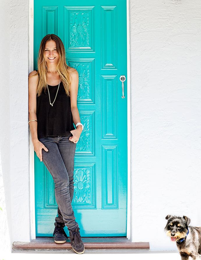 Liesel Petersen and Sammy the pound puppy greet visitors at the front door, painted a vivid shade of turquoise.
